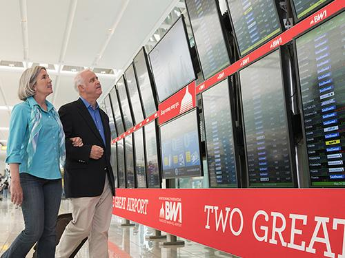 Couple checking the arrivals board